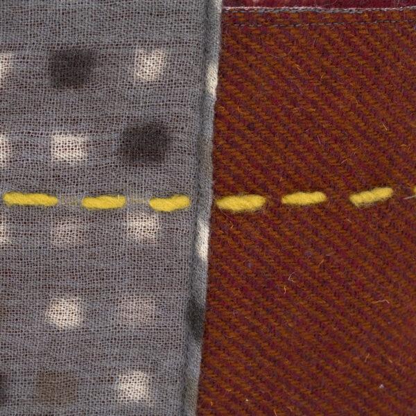 particolare del cuscino in lana